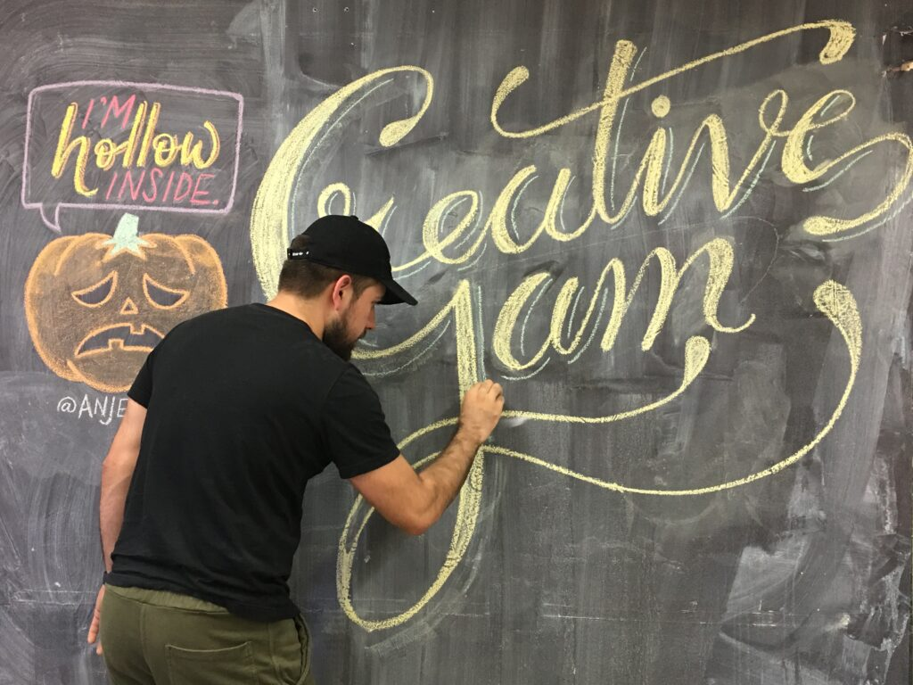 Long Beach State student writes Creative Jam on chalkboard